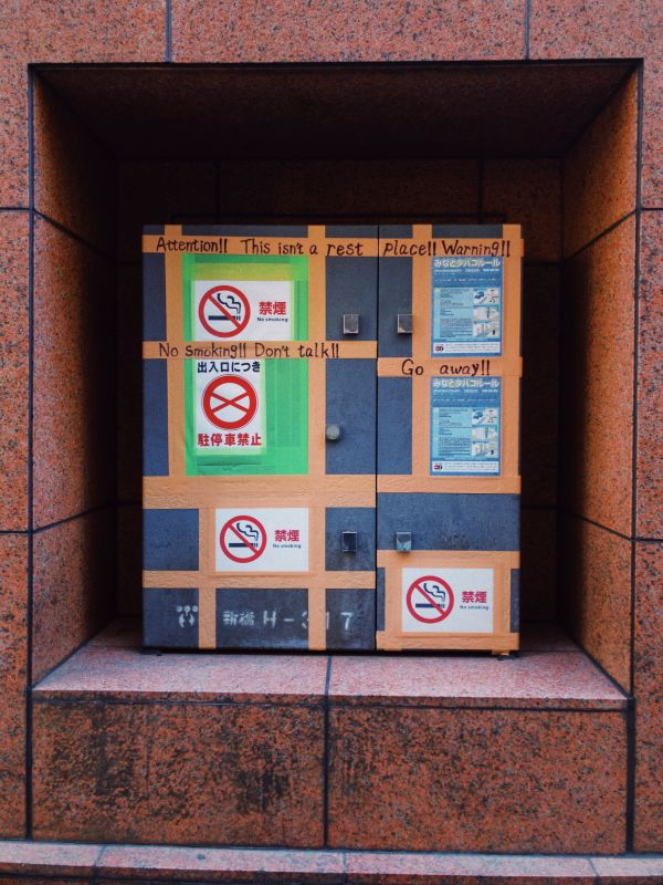 Photo - Makeshift English Non-smoking Signs on Duct Tape, photo by Rick Cogley